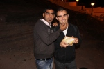 Prakesh introducing me the holy sweets 'Peda'
