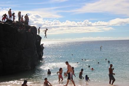 Amanda jumping off a 30-feet high cliff @ Waimea Beach